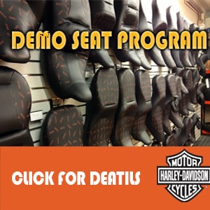 Motorcycle seats hanging on wall