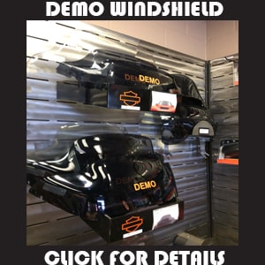 Motorcycle windshields hanging on wall